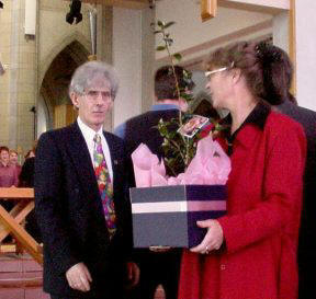John and Susan receive the gift of a Camellia.